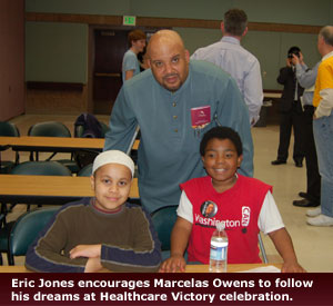 Empower Law - Eric Jones encourages Marcelas Owens to follow his dreams at Healthcare Victory celebration.