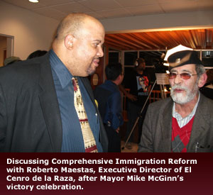 Empower Law - Discussing Comprehensive Immigration Reform with Roberto Maestas, Executive Director of El Cenro de la Raza, after Mayor Mike McGinn's victory celebration.